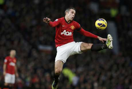 <p>Manchester United's Robin van Persie jumps to control the ball.</p>