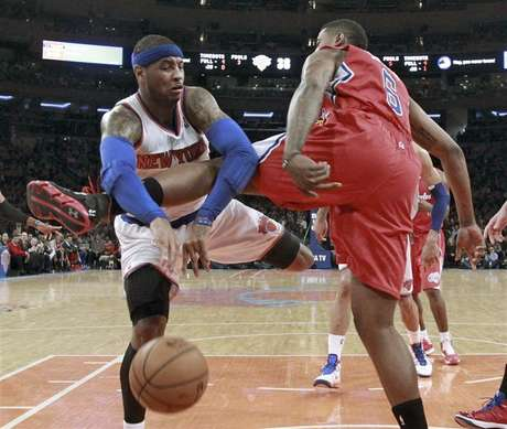 New York Knicks forward Carmelo Anthony (7) tries to pass against Los Angeles Clippers center DeAndre Jordan (6) in the first quarter of their NBA basketball game at Madison Square Garden in New York, February 10, 2013.