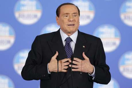 Former Italian prime minister Silvio Berlusconi speaks during a political rally in downtown Rome, February 7, 2013.