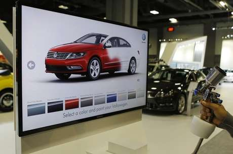 A unique Volkswagen consumer interactive display that allows potential buyers to spray paint different models in different colors is seen at the Washington Auto show February 6, 2013.