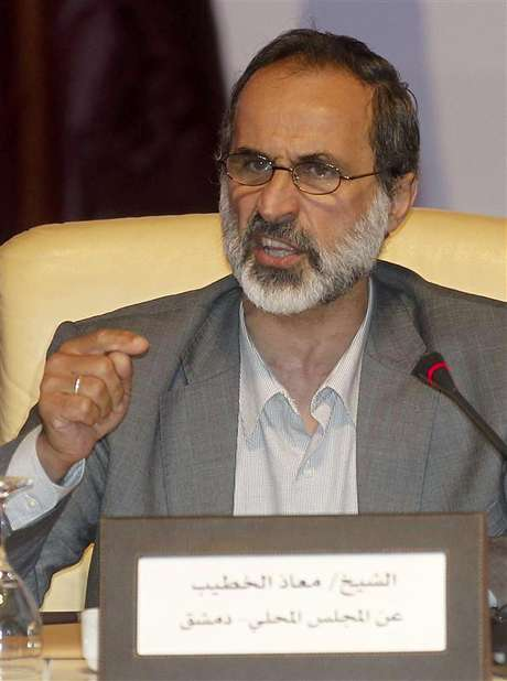 Activist preacher Mouaz al-Khatib speaks the General Assembly of the Syrian National Council in Doha November 11, 2012.