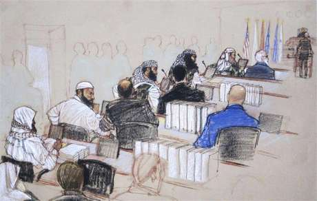 In this Pentagon-approved courtroom sketch, alleged 9/11 mastermind Khalid Sheikh Mohammad (L) confers with defense attorney Army Captain Jason Wright, after hearings convened for the day at the Guantanamo Bay U.S. Naval Base in Cuba February 11, 2013.