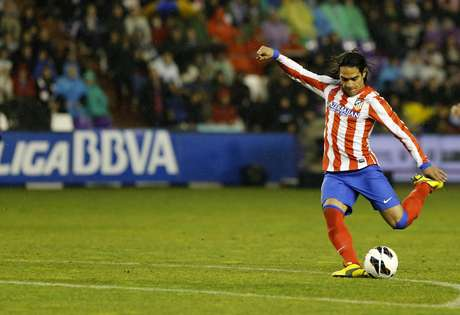 <p>Atletico Madrid's Colombian forward Radamel Falcao kicks the ball during the Spanish league football match Real Valladolid CF vs Atletico de Madrid at Jose Zorilla stadium in Valladolid on February 17, 2012.</p>