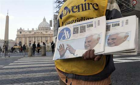 A newspaper seller shows newspapers with photographs of Pope Benedict XVI outside the Vatican February 17, 2013. Thousands of people are expected to gather in St. Peter's Square for Pope Benedict's Sunday Angelus prayer.