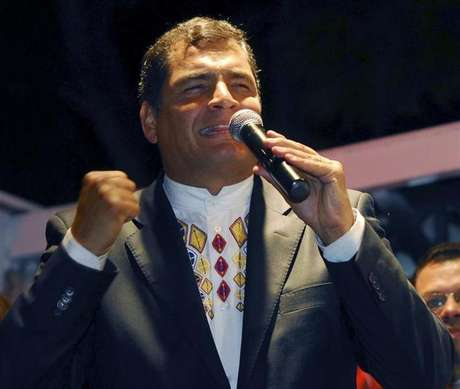 Ecuador's President Rafael Correa reacts after hearing the election results at Carondelet Palace in Quito February 17, 2013.