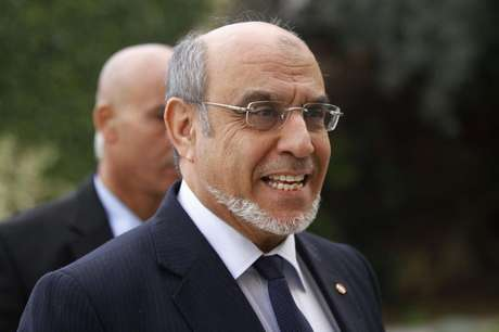Tunisian Prime Minister Hamadi Jebali he arrives for a round of consultations with other political parties at the Carthage Palace in Tunis, February 15, 2013.