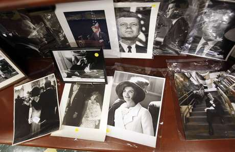 Photos of former U.S. President John F. Kennedy and his wife Jacqueline Kennedy Onassis are displayed among other items as part of the McInnis Auctioneers Presidential Auction in Amesbury, Massachusetts in this file photo from February 10, 2013.