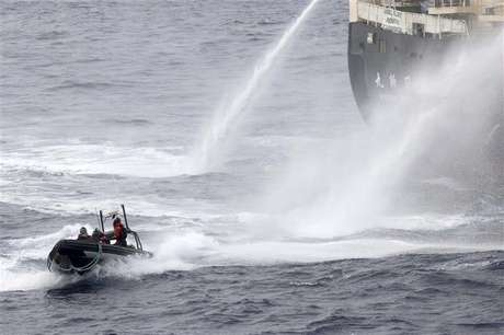 Japanese research vessel Nisshin Maru fires water cannons at the Sea Shepherd Delta boat in Mackenzie Bay, Antarctica in this handout picture taken on February 19, 2013 by Sea Shepherd Australia.