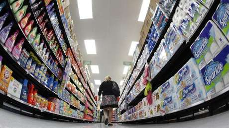 A shopper walks down an aisle in a newly opened Walmart Neighborhood Market in Chicago in this September 21, 2011 file photo.