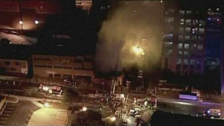 A still image taken from a KHSB-TV video footage shows emergency workers pulling a person on a gurney near the scene of the fire at Kansas City, Missouri February 19, 2013.