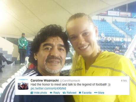 <p>Caroline Wozniacki tweeted this photo of her meeting with a soccer legend, Diego Maradona.</p>