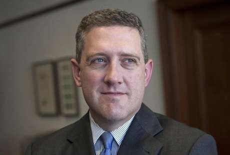 President and CEO of the Federal Reserve Bank of St. Louis James Bullard poses during an interview at the Federal Reserve Bank of St. Louis June 8, 2011.