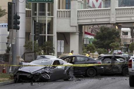 Wrecked cars are seen on Las Vegas Boulevard and Flamingo Avenue as Las Vegas Metro Police investigate a shooting and multi-car accident that left three people dead and at least three injured on the Las Vegas Strip in Las Vegas, Nevada in the early morning February 21, 2013.