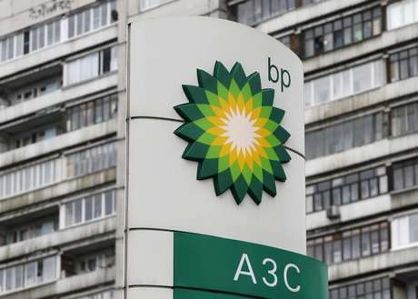 A BP logo is seen in front of an apartment block near a petrol station in Moscow October 22, 2012.