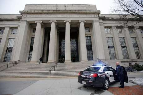 Cambridge police officers stand outside the main buildings of the Massachusetts Institute of Technology (MIT) in Cambridge, Massachusetts, February 23, 2013.