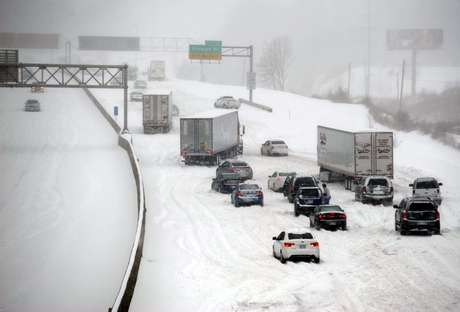 Stalled vehicles are seen during a blizzard as traffic comes to a standstill on the I-635 in Kansas City, Kansas, February 21, 2013.