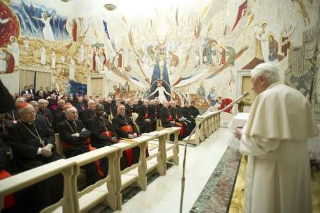 Pope Benedict XVI (R) speaks to Cardinals during the closing day of the Spiritual Exercises at the Vatican February 23, 2013.