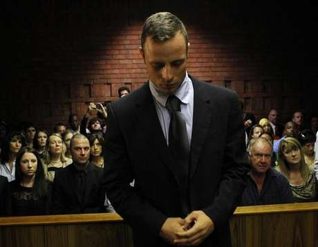 Oscar Pistorius stands in the dock ahead of court proceedings at the Pretoria magistrates court February 22, 2013.