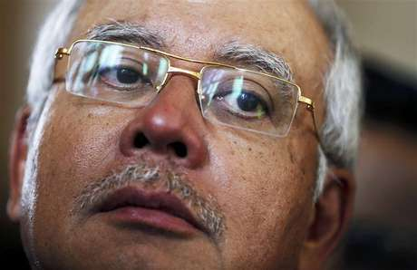 Malaysian Prime Minister Najib Razak listens to questions from reporters during a break in a plenary session on the second day of the Asia-Europe Meeting (ASEM) summit in Vientiane November 6, 2012.