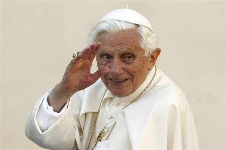 Pope Benedict XVI waves as he arrives to lead the Wednesday general audience in Saint Peter's square, at the Vatican in this October 24, 2012 file picture.