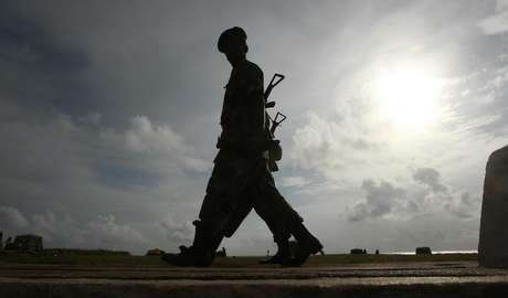 Army soldiers patrol along Galle face green in Colombo August 25, 2011.