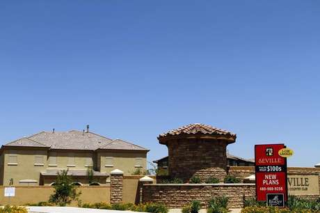 A sign advertising new homes starting at the price of $100,000 is displayed in Chandler Heights, Arizona June 2, 2011.