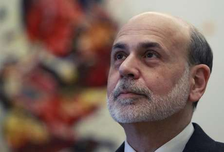 Federal Reserve Chairman Ben Bernanke waits before a meeting of the G20 Finance Ministers in Moscow February 15, 2013.