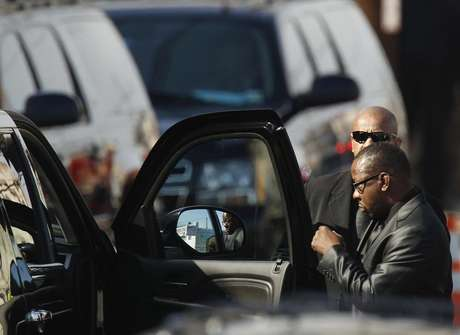 Whitney Houston's ex-husband, Bobby Brown leaves before the start of the funeral service for the pop singer at the New Hope Baptist Church in Newark, New Jersey February 18, 2012.