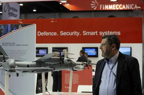 A visitor walks past a stand for Italian defence group Finmeccanica during the International Defence Exhibition and Conference (IDEX) at the Abu Dhabi National Exhibition Centre February 19, 2013.
