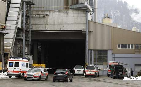 Police and rescue service vehicles are seen in front of the wood processing plant of Kronospan following a shooting in Menznau near Lucerne February 27, 2013. Swiss police said in a brief statement that three people had been killed and seven seriously injured at a shooting at the plant.