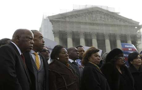 U.S. Rep. John Lewis (D-GA) (L) and Rev. Al Sharpton (2nd L) attend a voter's rights rally in front of the U.S. Supreme Court in Washington February 27, 2013. The U.S. Supreme Court on Wednesday will consider whether to strike down a key provision of a federal law designed to protect minority voters. During the one-hour oral argument, the nine justices will hear the claim made by officials from Shelby County, Alabama, that Section 5 of the Voting Rights Act is no longer needed.