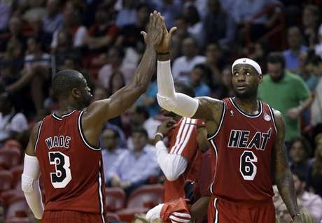 LeBron James and Dwyane Wade high five during the Heat's double-overtime win over the Kings. The duo scored 79 of Miami's 141 points.