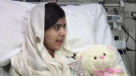 Pakistani schoolgirl, Malala Yousufzai, who was shot in the head by the Taliban for advocating girls' education, is seen sitting in her hospital bed in this undated still picture taken from video provided by the Queen Elizabeth Hospital, in Birmingham, central England, and received in London on February 4, 2013.
