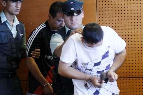 Sujetos detenidos por la PDI tras el robo al camión de valores.