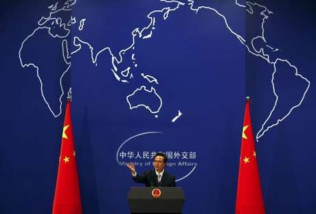 China's Foreign Ministry spokesman Hong Lei asks journalists for questions during a news conference in Beijing July 7, 2011.