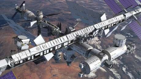 <p>Concepção artística mostra o espectrômetro magnético instalado na Estação Espacial Internacional</p>