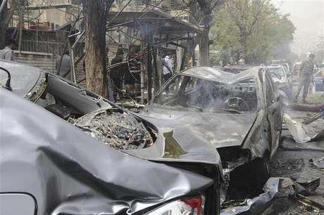 A view shows wreckage of cars after a suicide car bomb exploded in the main business district of Damascus April 8, 2013, in this handout photograph distributed by Syria's national news agency SANA .The death toll from a suicide car bomb which exploded in central Damascus on Monday rose to 15, with 47 wounded, Syrian state television said.