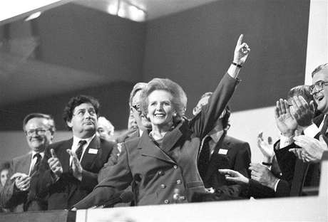 Then British Prime Minister Margaret Thatcher points skyward as she receives standing ovation at Conservative Party Conference in this October 13, 1989 file photo. Thatcher has died following a stroke, a spokesman for the family said.