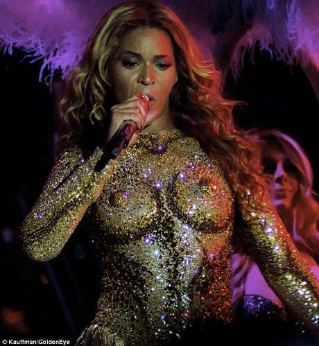 "Singer Beyoncé performs on the opening night of her ""Mrs. Carter Show World Tour 2013"", on Monday, April 15, 2013 at the Kombank Arena in Belgrade, Serbia. Beyonce is wearing a custom, hand beaded white peplum one-piece by designers Ralph & Russo."