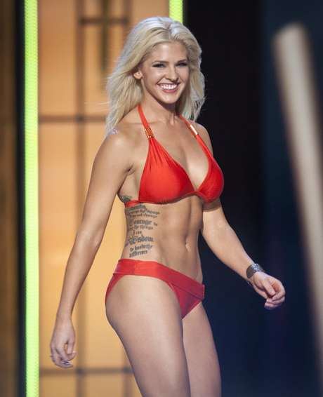 Miss Kansas, Theresa Vail, is seen on stage during the bathing suit portion of the preliminary round of the Miss America pageant in Atlantic City, New Jersey, September 10, 2013. Miss America will be crowned during the final ceremony on Sunday, September 15. Vail is believed the be the first contestant in the pageant's history to show off her tattoos. REUTERS/Carlo Allegri  (UNITED STATES - Tags: ENTERTAINMENT SOCIETY)