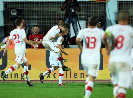 Suíça comemora gol de Michael Lang
