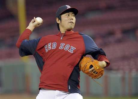 Oct 22, 2013; Boston, MA, USA; Boston Red Sox relief pitcher Koji Uehara (19) throws a pitch during workouts the day before game one of the 2013 World Series against the St. Louis Cardinals at Fenway Park. Mandatory Credit: Bob DeChiara-USA TODAY Sports.