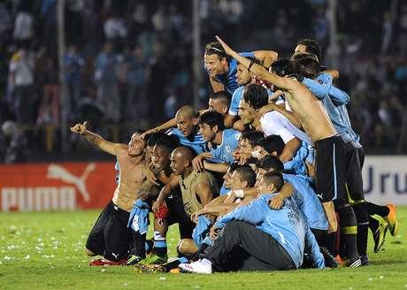 <p>Uruguai festejou vaga na Copa do Mundo de 2014 ap&oacute;s empate sem gols diante da Jord&acirc;nia</p>
