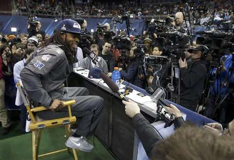 Seattle Seahawks cornerback Richard Sherman is surrounded by cameras during Media Day for Super Bowl XLVIII at the Prudential Center in Newark, New Jersey January 28, 2014.