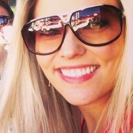 Com o filho nas costas, modelo Lorrane Melo, 27 anos, levou um tiro na cabeça durante um assalto a sua casa na cidade de Goiânia (GO)