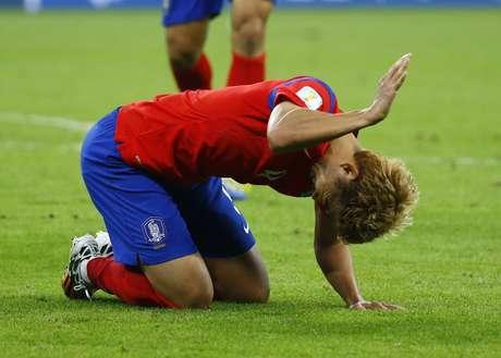 <p>Son Heung-min reage a uma chance perdida de gol</p>