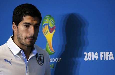 Uruguay's national soccer team player Luis Suarez arrives at a news conference prior a training session at the Dunas Arena soccer stadium in Natal, June 23, 2014.