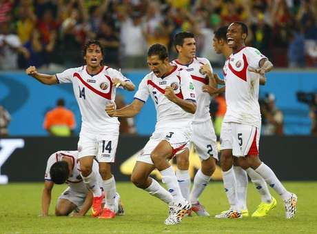 Costa Rica's players celebrate winning their 2014 World Cup round of 16 game against Greece at the Pernambuco arena in Recife June 29, 2014.