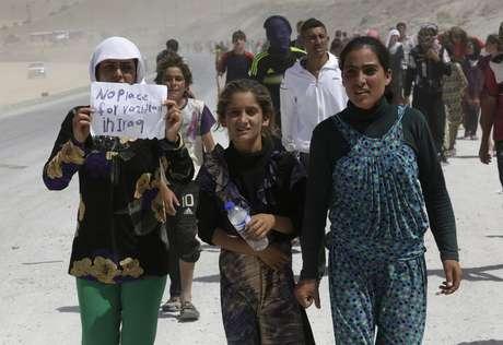 <p>Deslocados da minoria Yazidi marcham em direção aoCurdistão iraquiano em 17 de agosto</p><p></p>