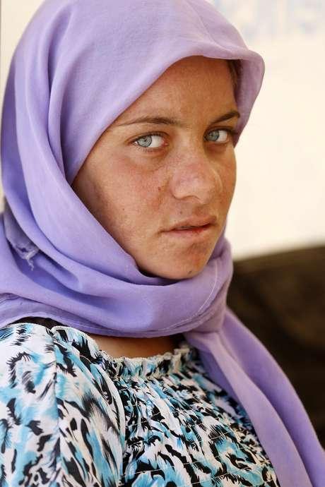 Refugiada yazidi é fotografada em Dohuk; dezenas de mulheres estão sendo escravizadas por jihadistas